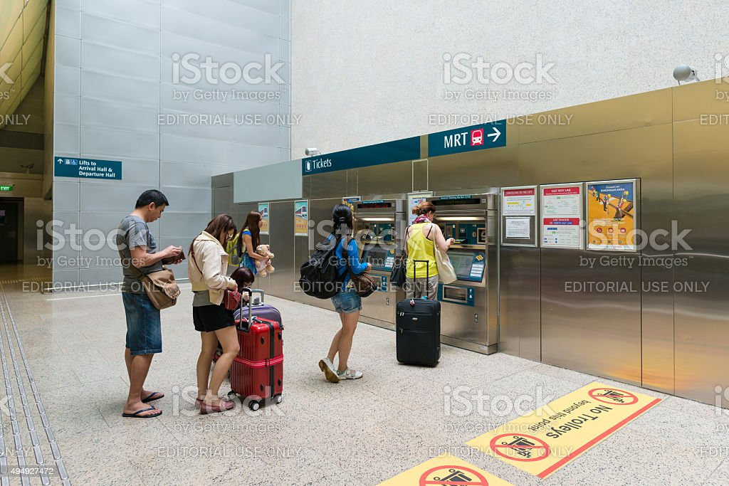 Tourists buy tickets at The Mass Rapid Transit in Singapore stock photo