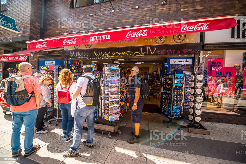 Tourists buying souvenirs in Stockholm, Sweden stock photo