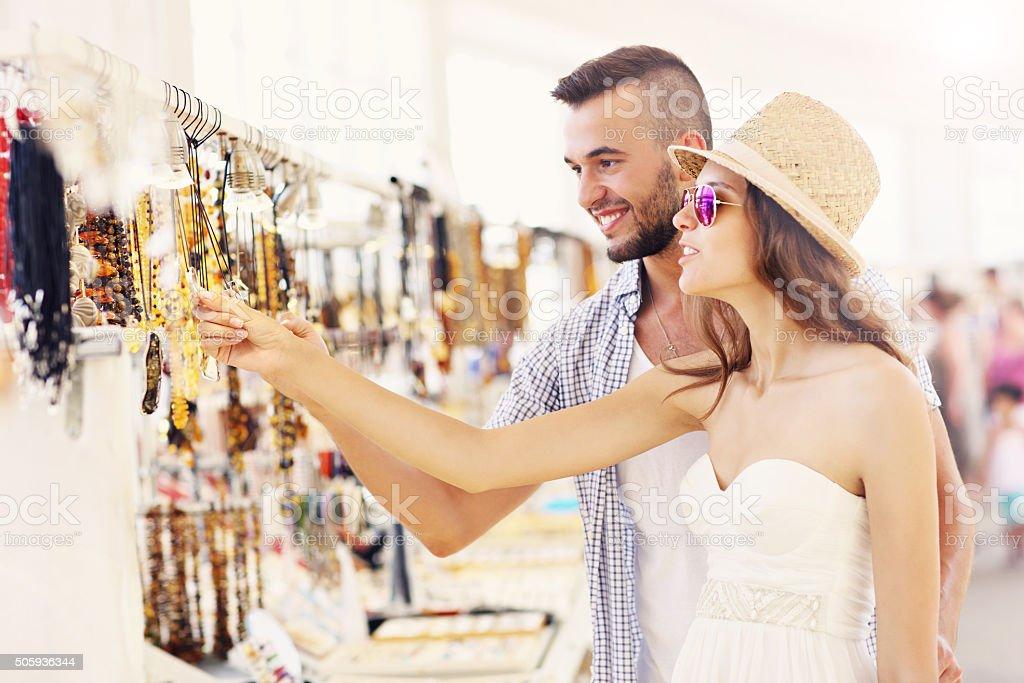 Tourists buying souvenirs stock photo