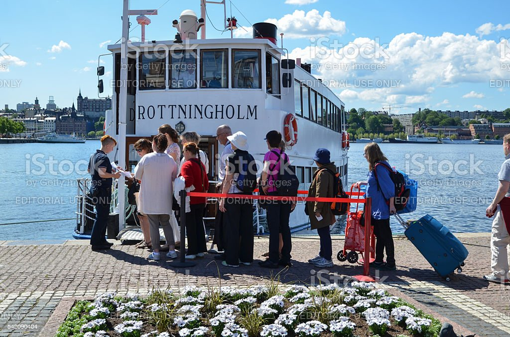 Tourists by a sightseeing boat in Stockholm stock photo