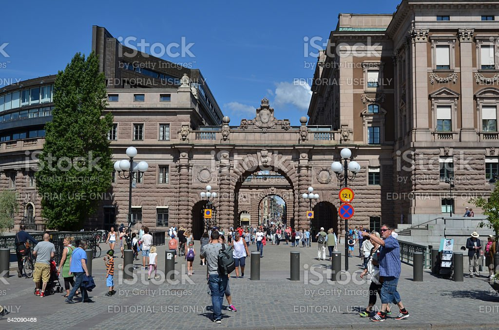 Tourists by the parliament house in Stockholm stock photo