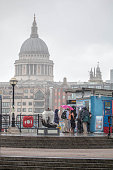 Tourists Caught In Heavy Rain By Thames, London