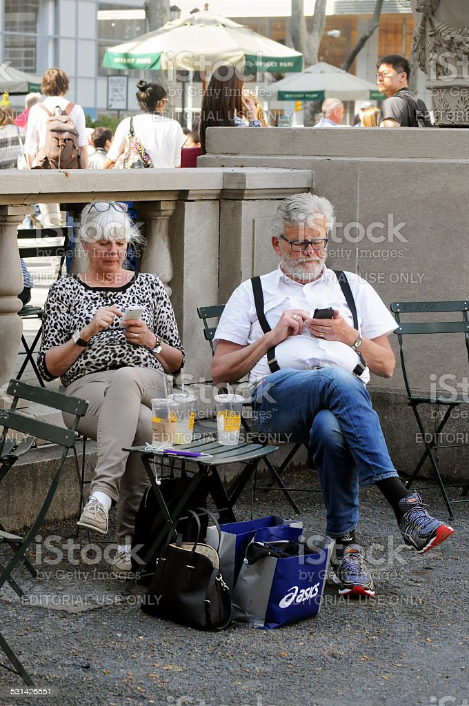 Tourists check cellphones in New York City stock photo