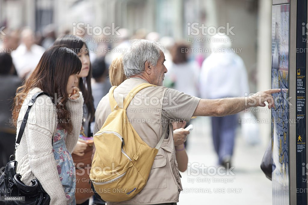 Tourists checking the city map royalty-free stock photo