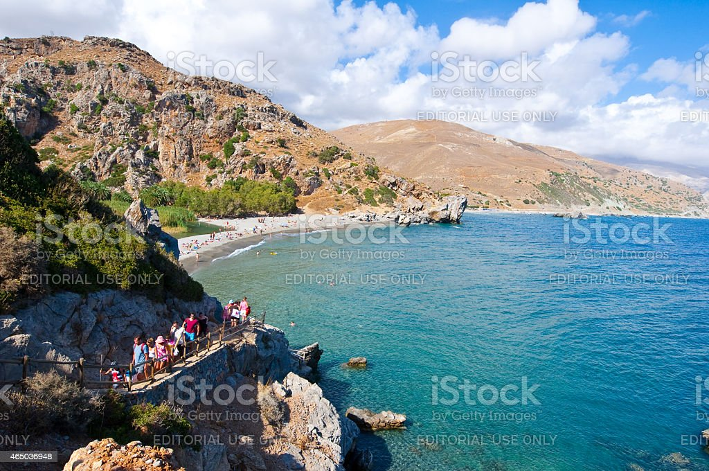 Tourists come down on the Preveli Beach on Crete, Greece. stock photo