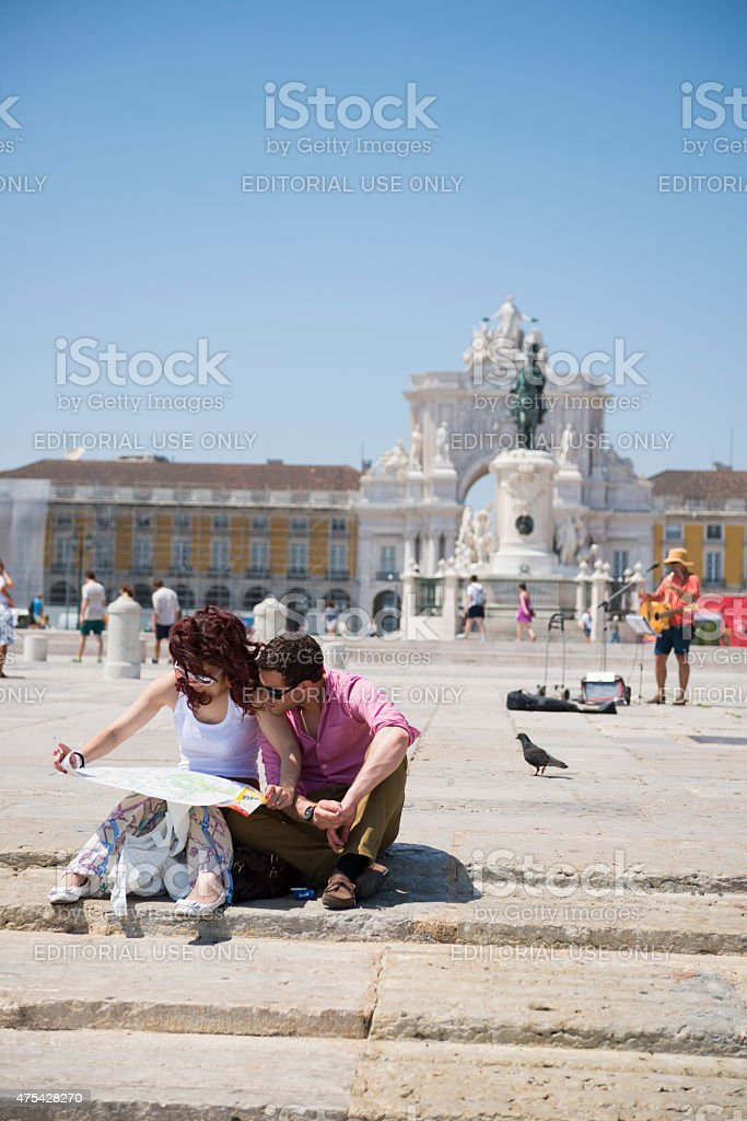 Tourists consulting map in Lisbon, Portugal stock photo