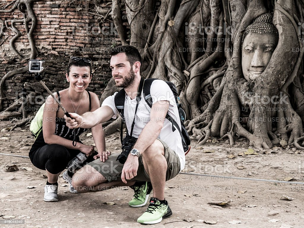 Tourists couple doing a selfie at a landmark in Ayutthaya stock photo