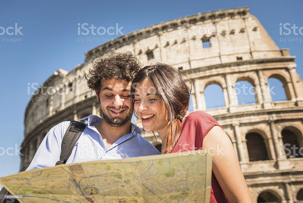 Tourists couple in Rome in front of Colosseum stock photo