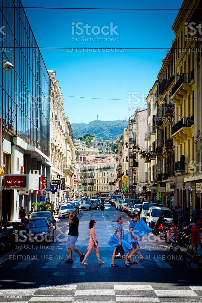 Tourists crossing a road in Nice, France stock photo