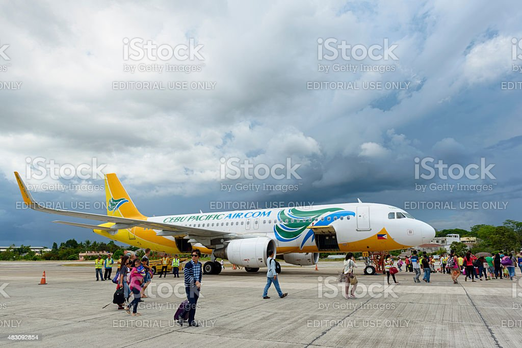 Tourists departing on Bohol airport with Cebu Pacific Air stock photo