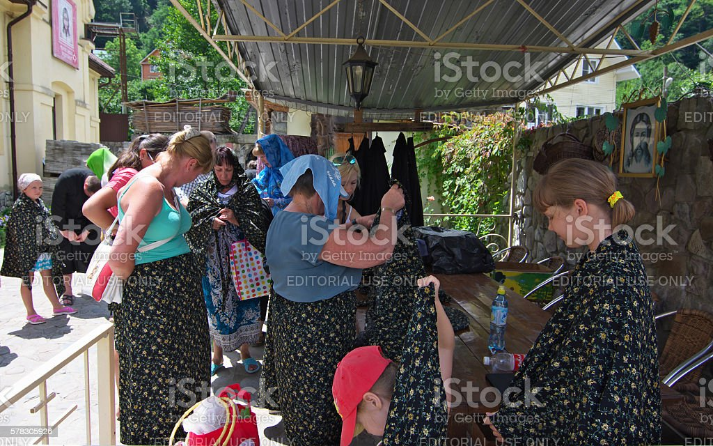 Tourists dress up to visit an Orthodox church stock photo