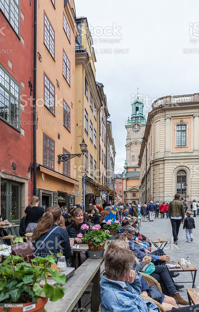 Tourists drinking coffee and resting at Stortorget square stock photo