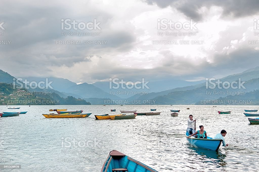 Tourists enjoy boat ride before a strong thunder-storm, natural colors. stock photo