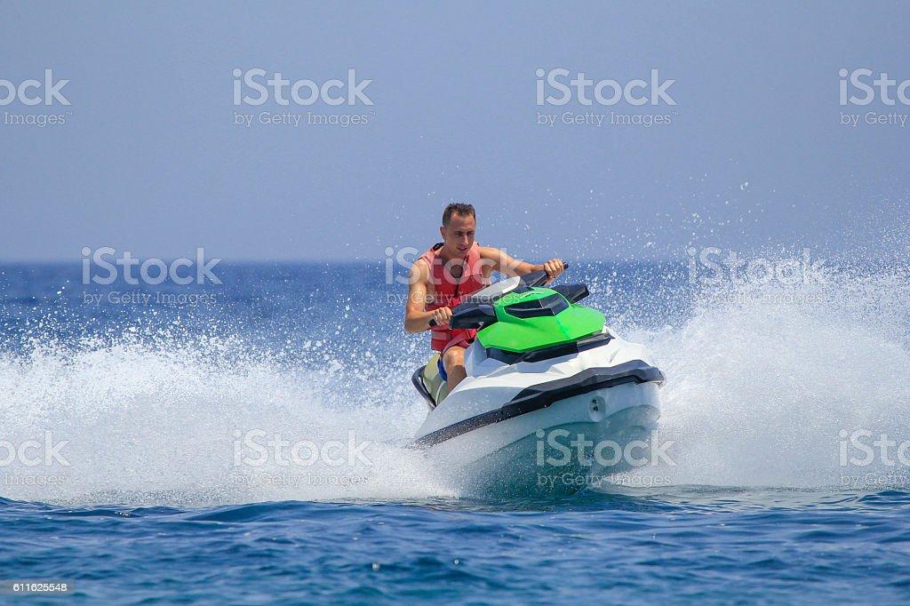 Tourists enjoy driving jetski on the ocean stock photo