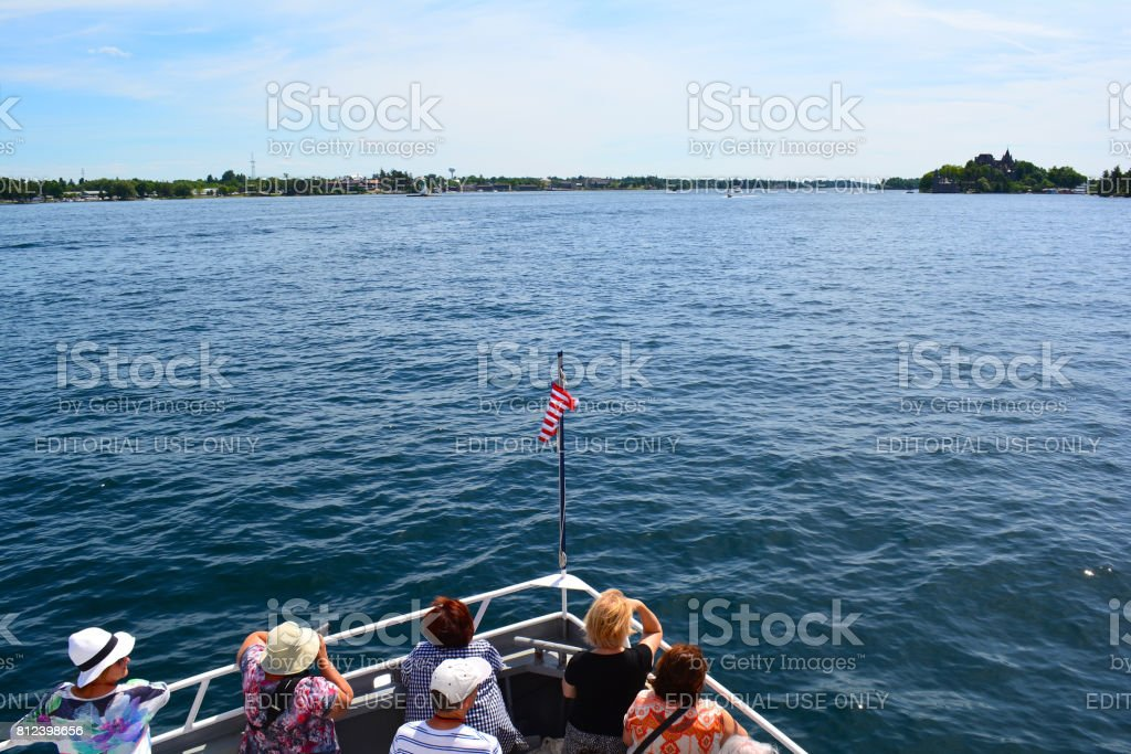 Tourists enjoy sunny day on the boat. stock photo