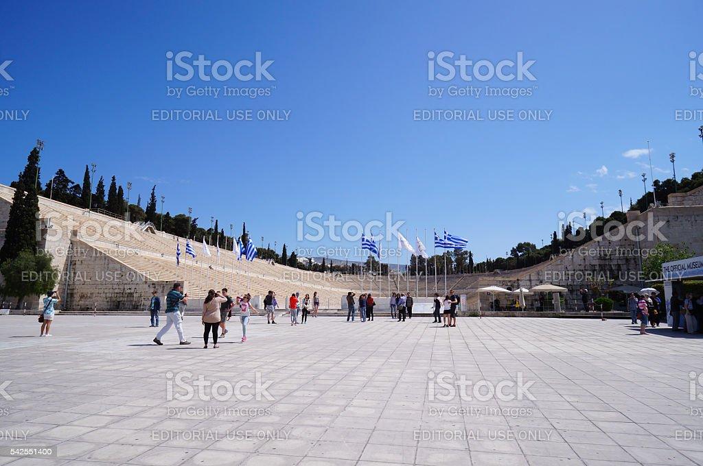 Tourists enjoy taking photograph at Panathenaic Stadium in Athens. stock photo