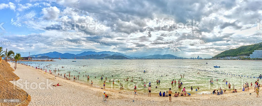 Tourists enjoy the beach late in the afternoon stock photo