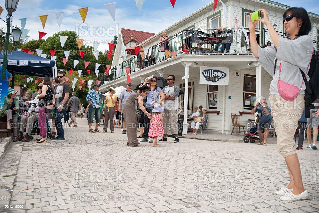 Tourists enjoying Tauranga Historic Village. stock photo
