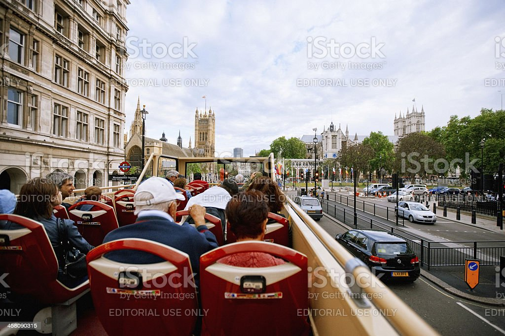 Tourists enjoying the ride on a Tour Bus in London royalty-free stock photo