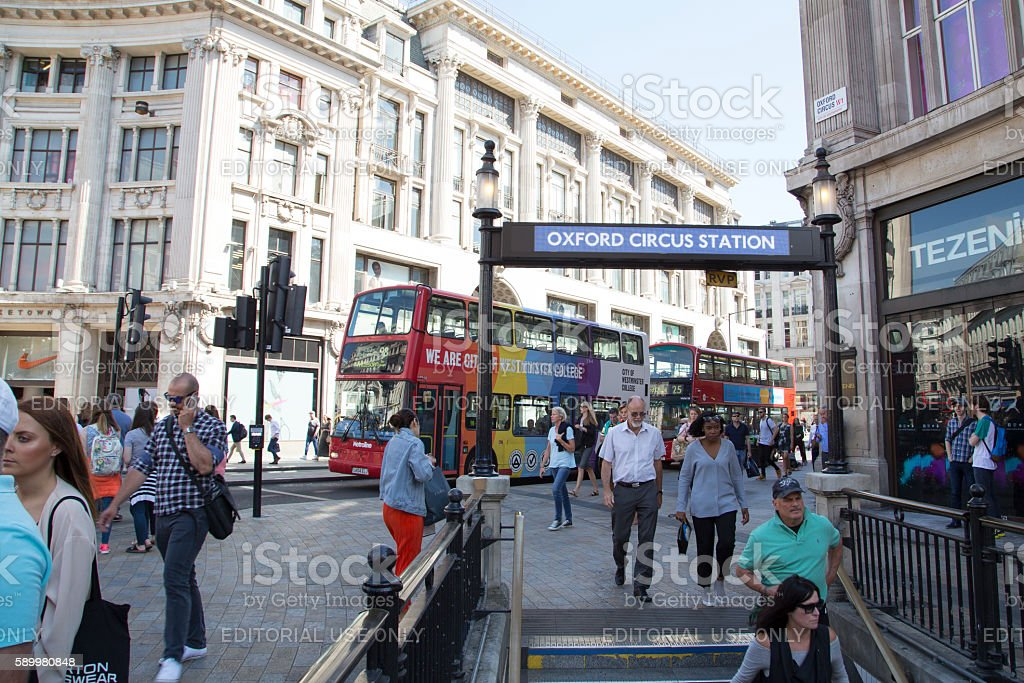 Tourists enter Oxford circus underground station. stock photo