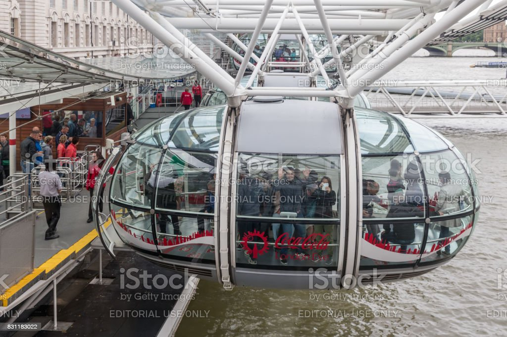 Tourists entering a cabin of London Eye in London, England stock photo
