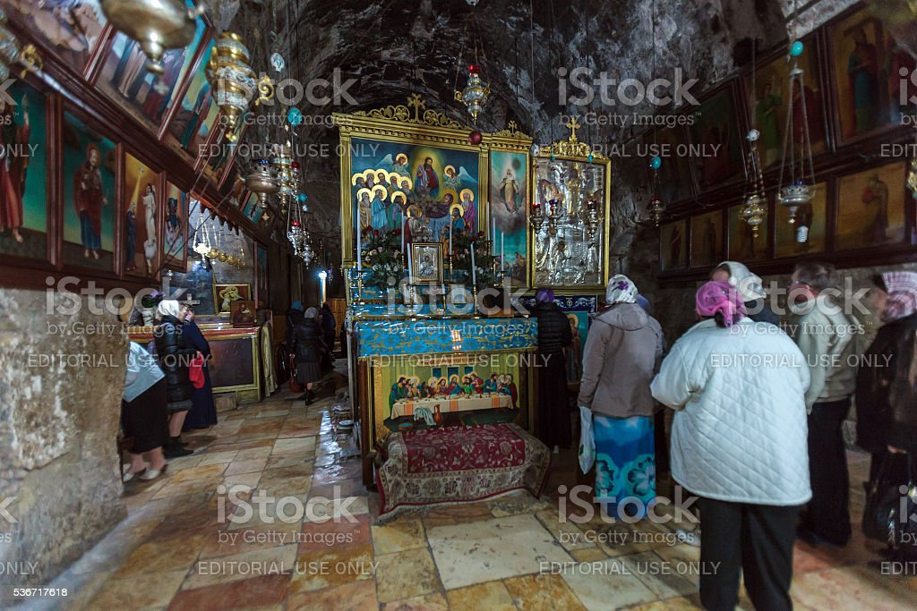 Tourists entering sarcophagus in tomb of the Virgin Mary stock photo
