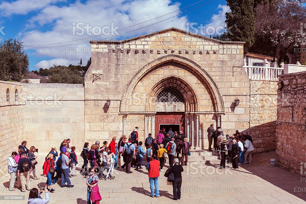 Tourists entering tomb of the Virgin Mary stock photo