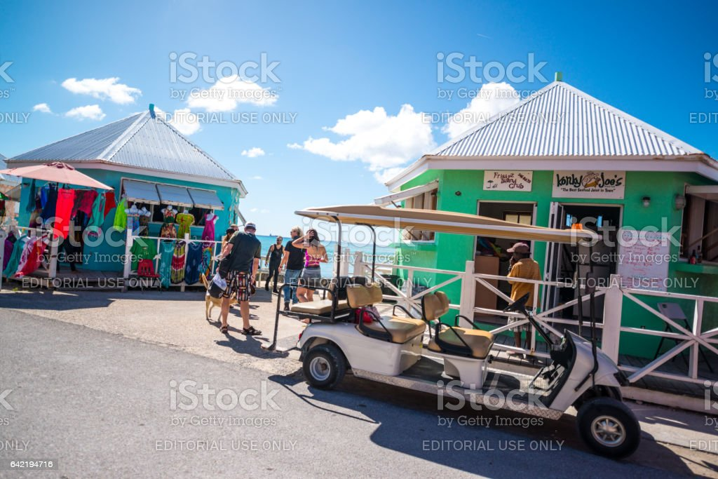 Tourists exploring historic Cockburn Town downtown, Grand Turk, Turks and Caicos islands stock photo