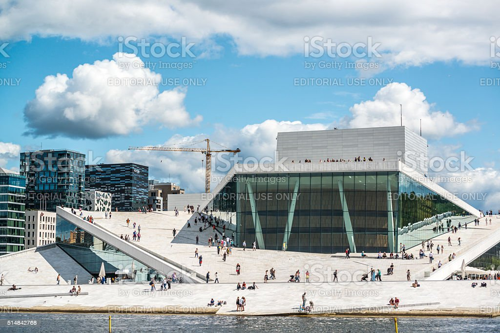 Tourists exploring Oslo Opera House, Norway stock photo