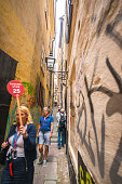 Tourists exploring the narrowest street in Stockholm, Sweden