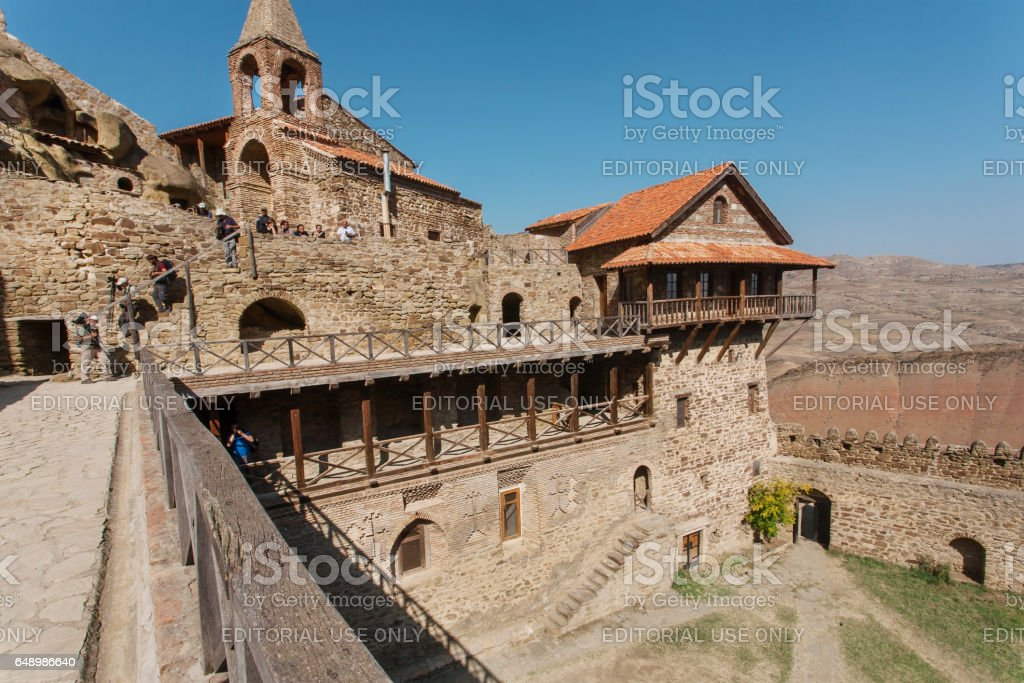 Tourists explorng structure of the 6th century David Gareja monastery, Georgia stock photo