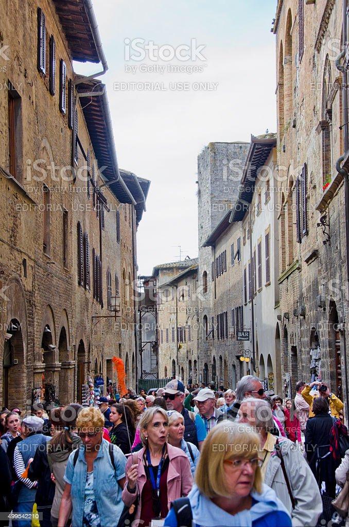 Tourists Fill the Streets of San Gimignano, Italy stock photo