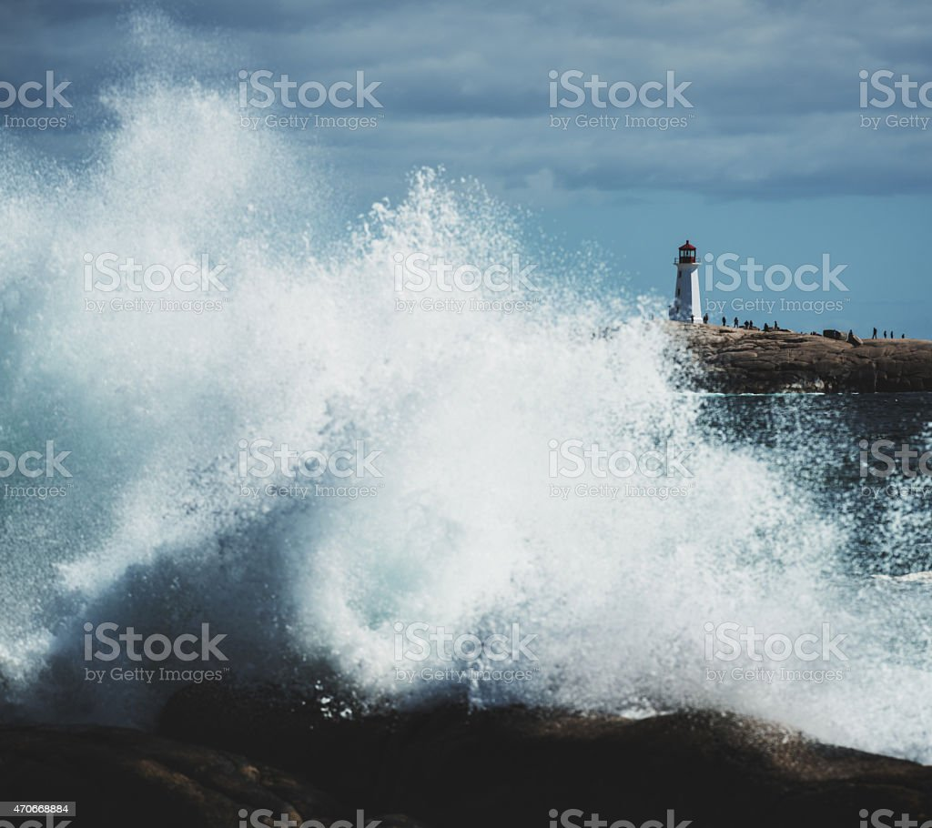 Tourists Flock to Peggy's Cove Lighthouse stock photo