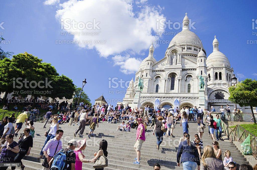 Tourists gather at the steps of Basilique du Sacré-Cœur stock photo