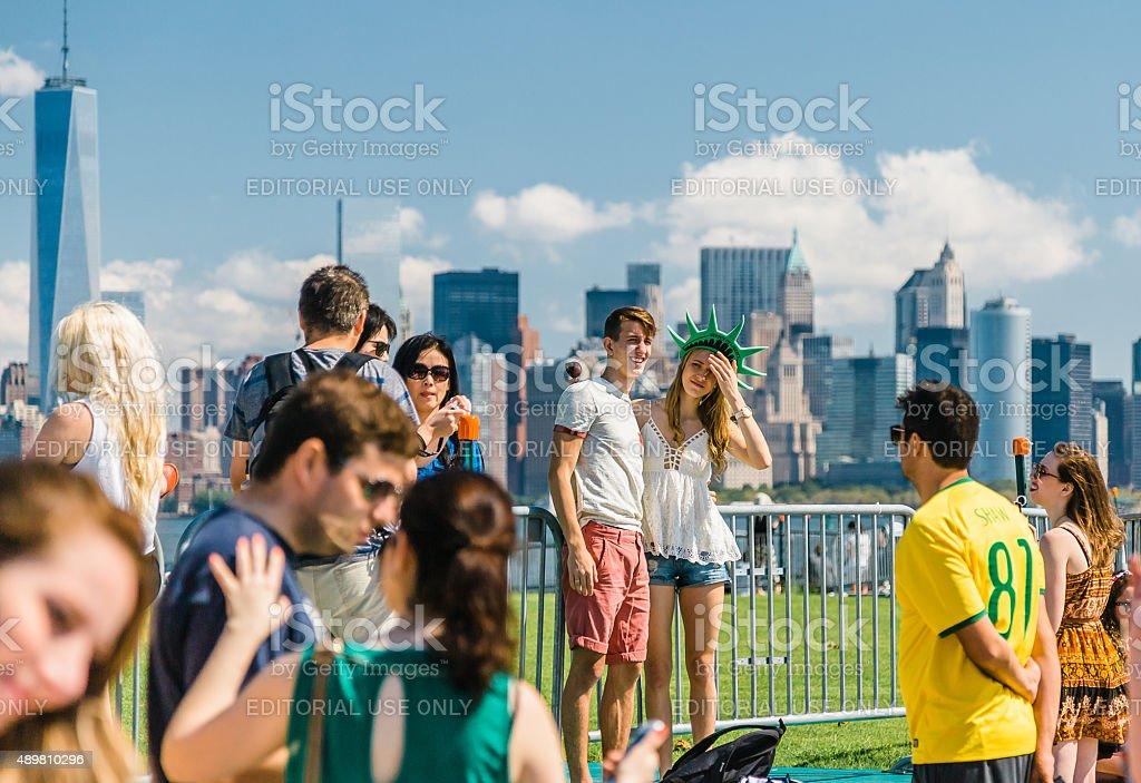 Tourists gather on Liberty Island in New York stock photo