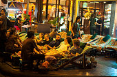 Tourists getting foot massage in Khao San Road