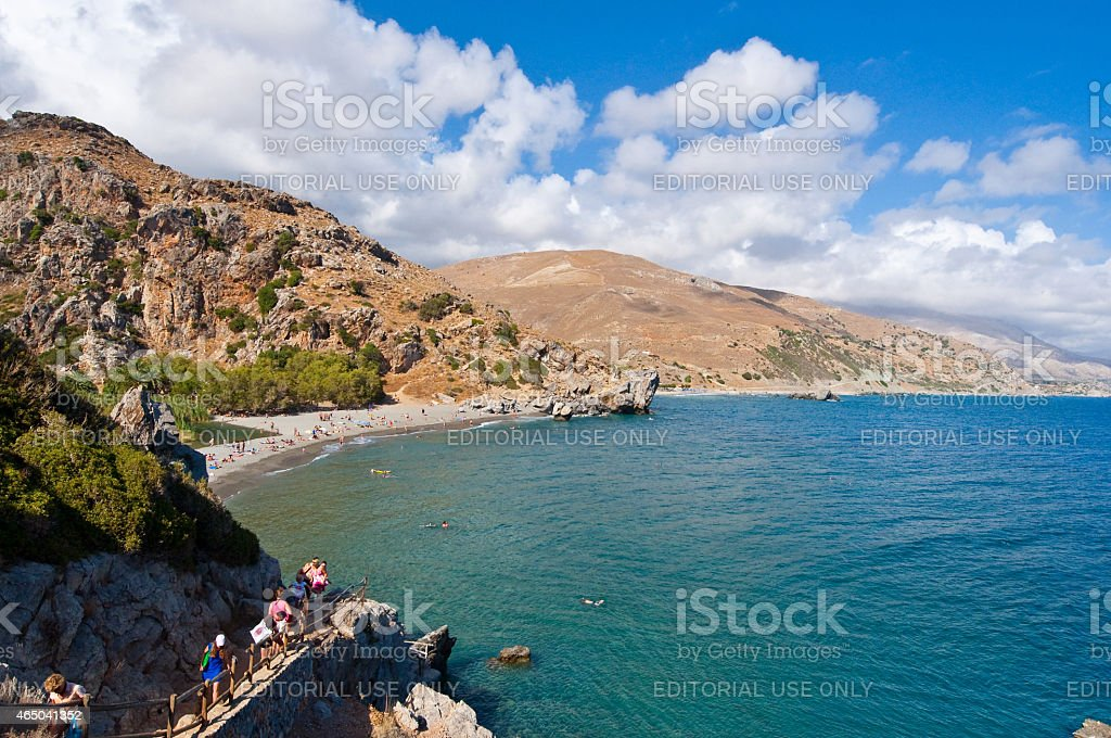 Tourists go down to the Preveli Beach on Crete, Greece. stock photo