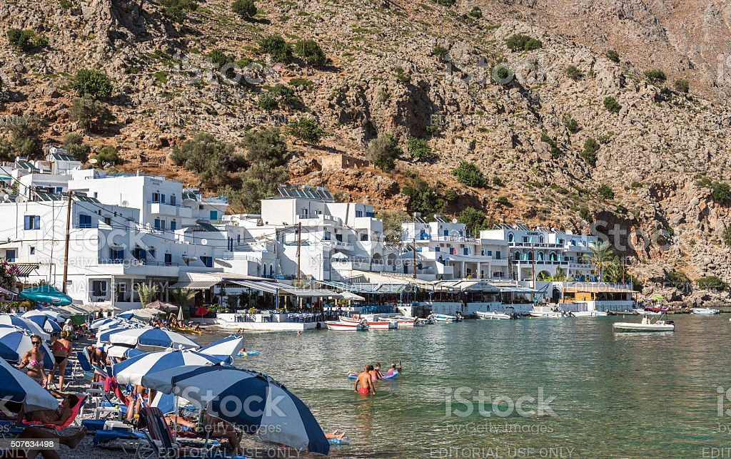 Tourists have a rest in small Loutro town stock photo