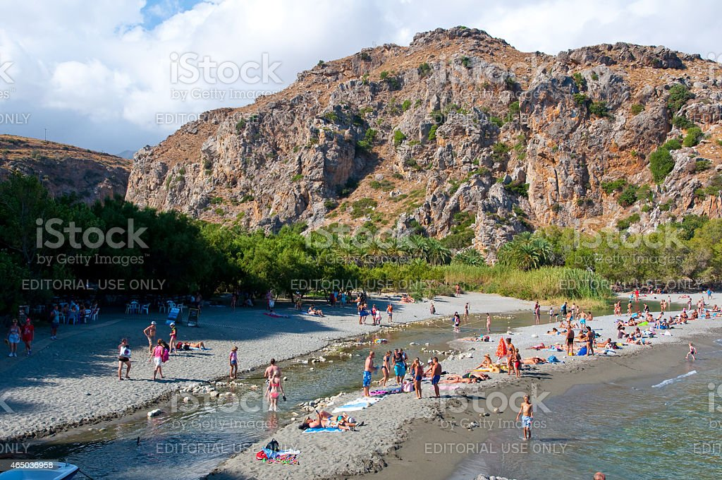 Tourists have a rest on the Preveli Beach. Crete, Greece. stock photo