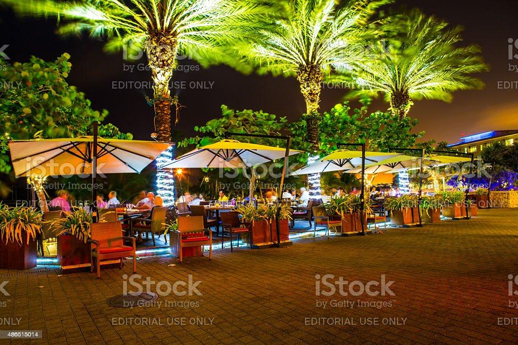 Tourists having dinner outdoors on Camana Bay on Grand Cayman stock photo