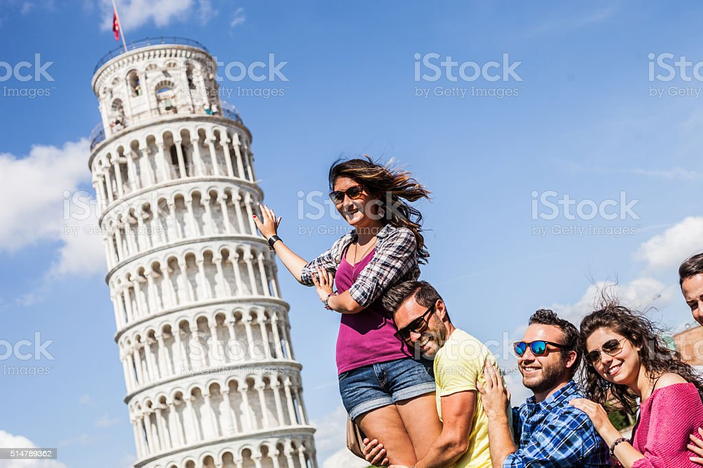 Tourists having fun in Pisa stock photo
