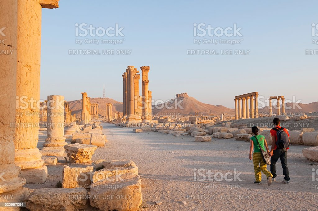 Tourists holding hands in ancient Palmyra, Syria stock photo