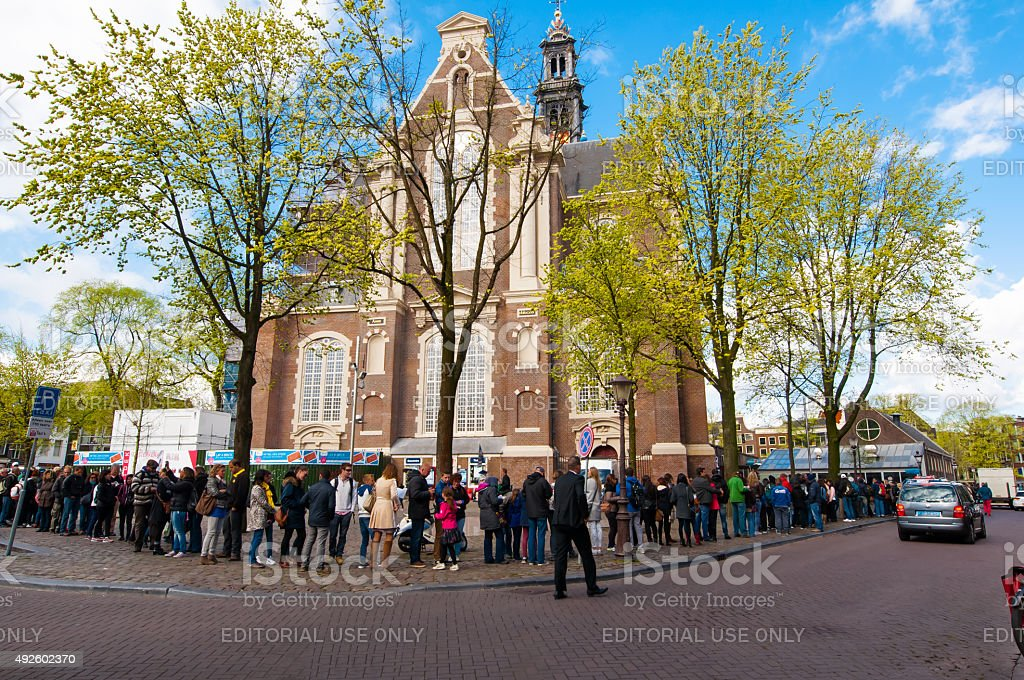 Tourists in a queue to Anne Frank House Museum. stock photo