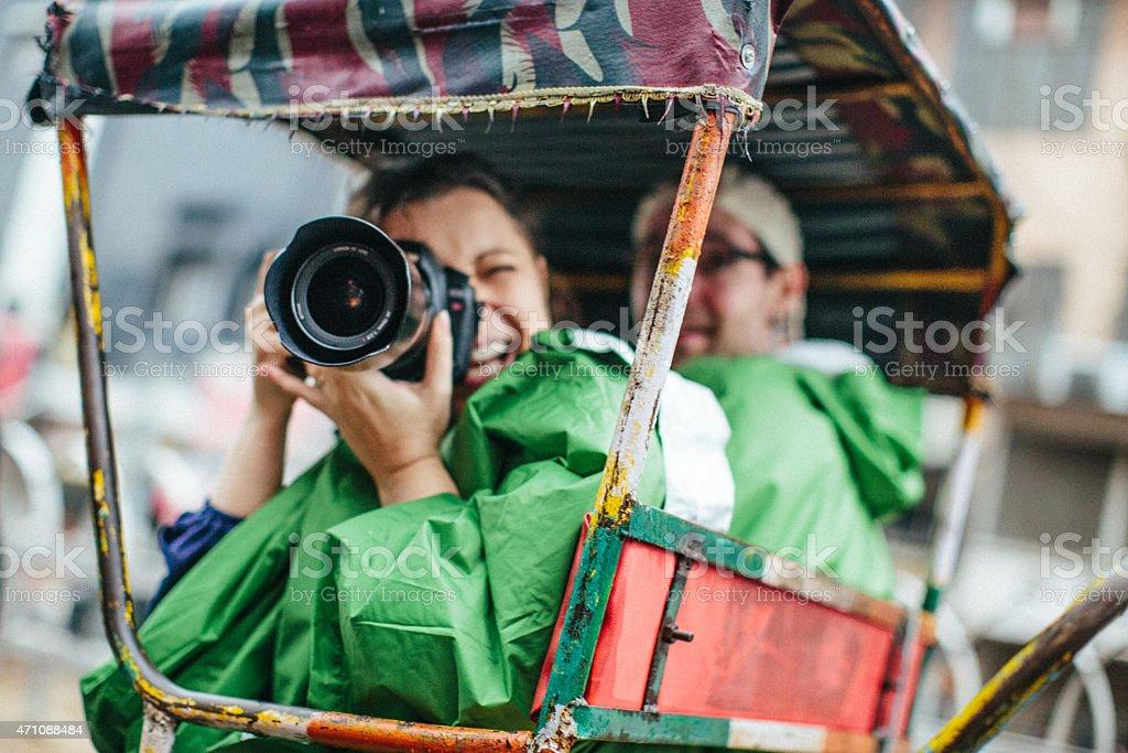 Tourists in a Rickshaw stock photo