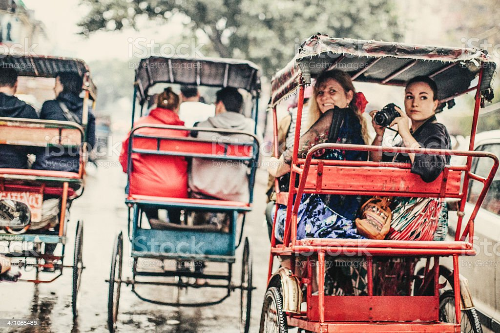 Tourists in a Rickshaw stock photo