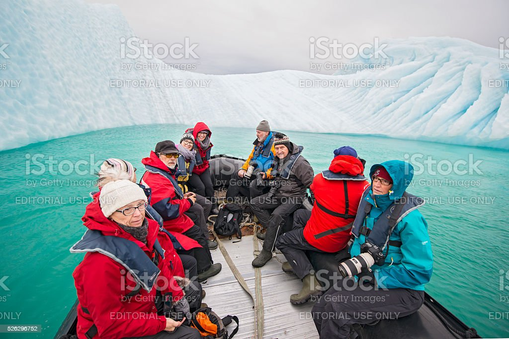 Tourists in a Zodiac in front of an iceberg, Greenland stock photo