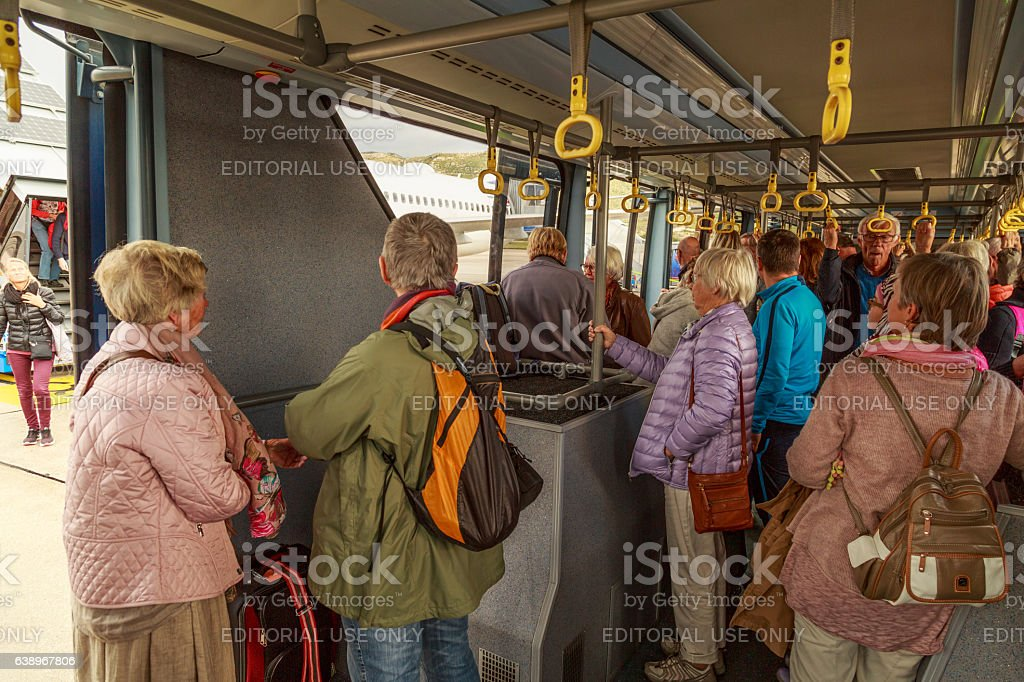 Tourists in an airport bus stock photo