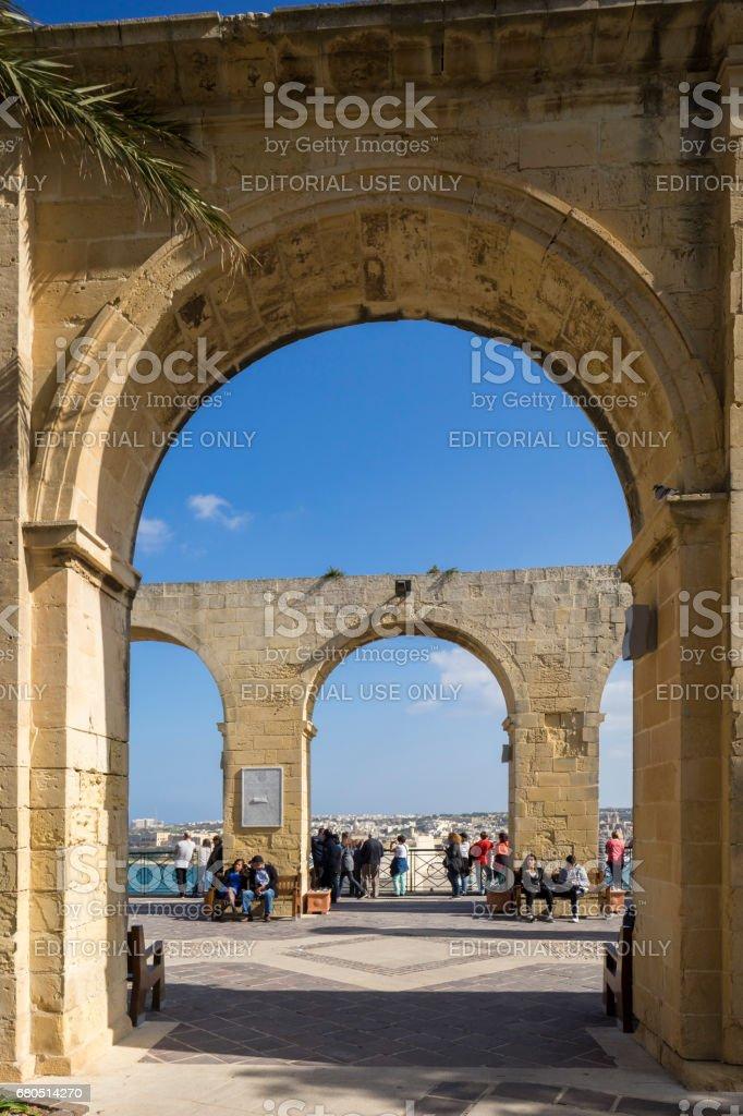 Tourists in Archways at Barrakka Gardens, Valletta, Capital City of Malta stock photo