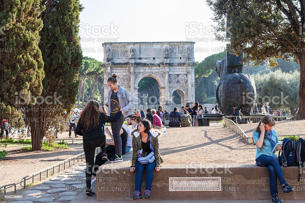 tourists in area of base The Colossus of Nero stock photo