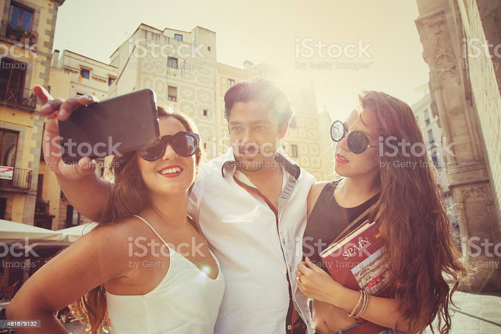 Tourists in Barcelona take a selfie stock photo